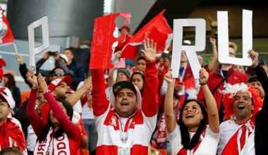Peru soccer team celebrating as they win first World Cup game in 40 years