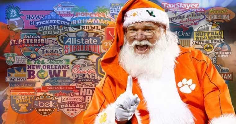 Santa in front of bowl game logos