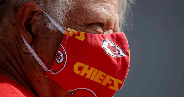 Kansas City Chiefs fan wearing a Chiefs-themed COVID-19 mask
