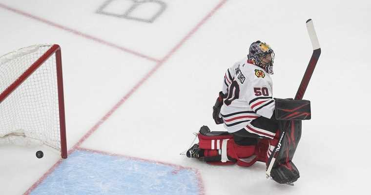 Chicago Blackhawks goalie lets the puck get by him into the net