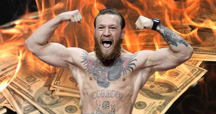 Conor McGregor in front of some cash on fire for his second fight against Poirier at UFC 257
