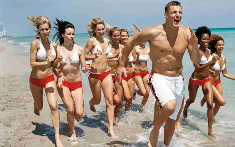 Rob Gronkowski Tampa Bay Buccaneers Tight End jogging with ladies having fun on the beach