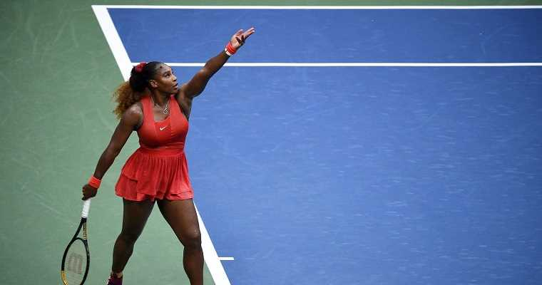 Serena Williams about to hit a serve at the US Open