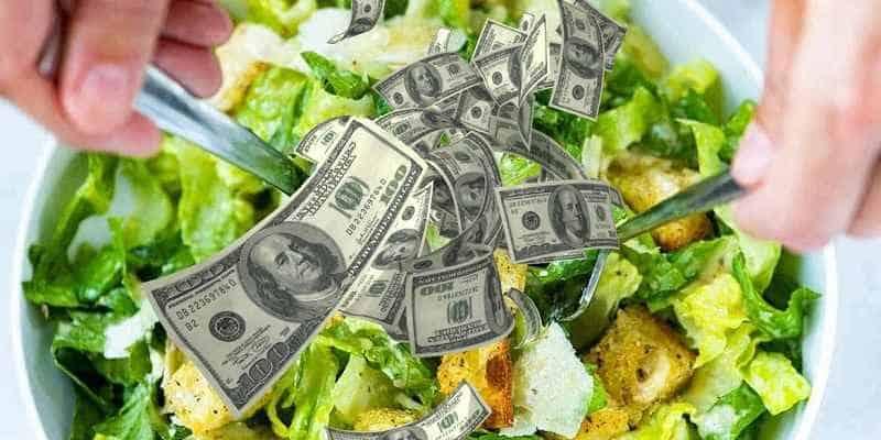 caesar salad with dollar bills