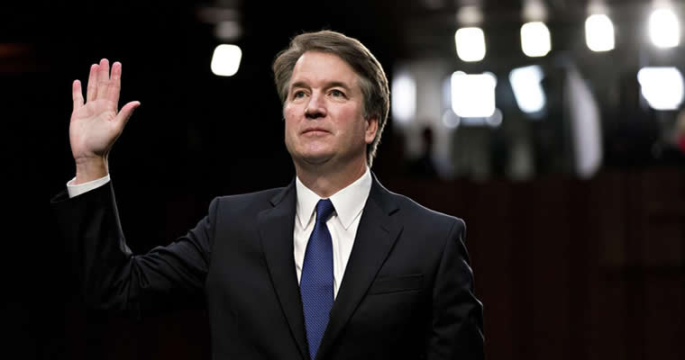 Kavanaugh holding up his right hand